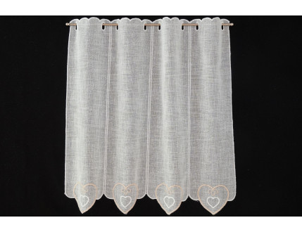 Simple window curtain with heart decoration on the lower part