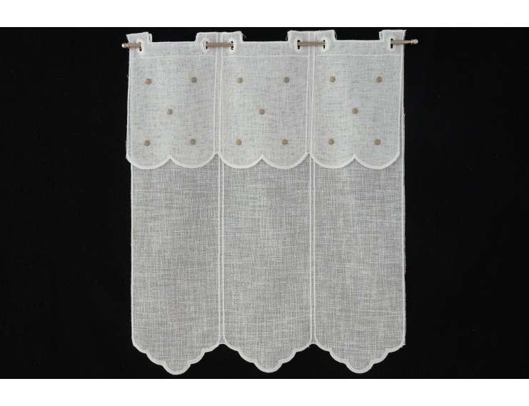 Window curtain with creme colored dots