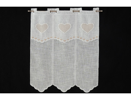 Window curtain with creme colored heart decoration