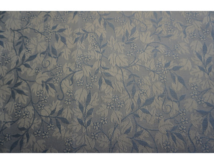 Jacquard fabric in mixed cotton and linen with blue leaves