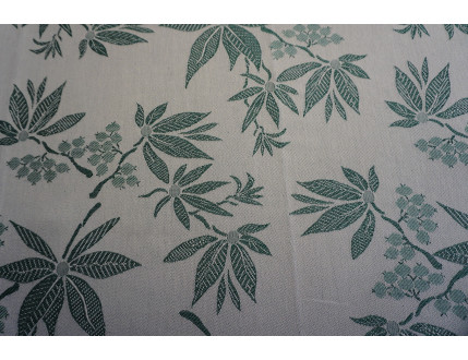 Jacquard fabric in mixed cotton and linen with green leaves