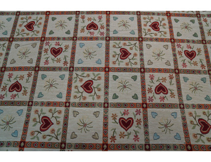 Checkered gobelin fabric with red hearts
