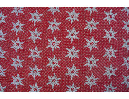 Tessuto jacquard rosso in misto cotone e lino con edelweiss