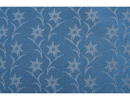 Tessuto jacquard celeste in misto cotone e lino con edelweiss